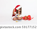 Sad girl in Santa Claus costume with inappropriate 59177152