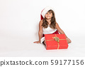 Cute little girl with Christmas gift 59177156