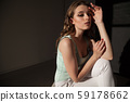 Portrait of a beautiful fashionable woman in light clothes 59178662