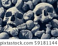 Skulls and bones in a wall 59181144