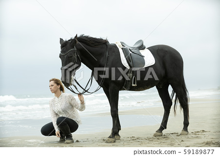 riding girl and horse 59189877