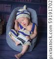 Adorable newborn baby sleeping in cozy room. 59191702