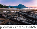 El Nido village with local banca boats on shore lit by sunset light at low tide. Picturesque nature 59196697
