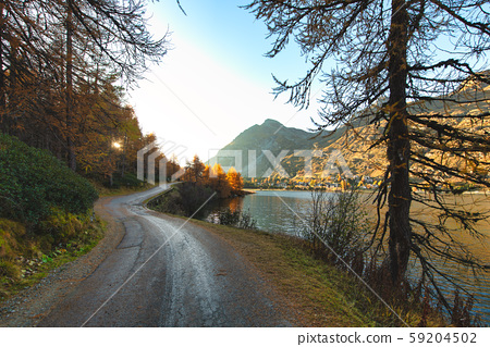 Isolated mountain road near the lake in the autumn 59204502