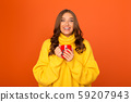 Excited woman enjoying hot tea, holding cup 59207943
