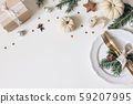 Traditional Christmas table place setting. Golden cutlery, porcelain plate, fir tree branches, gift 59207995