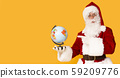Santa Claus holding globe and showing North Pole with finger 59209776