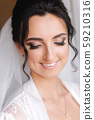 Close up portrait of gorgeous bride at hotel in morning. Charming woman with great hairstyle and 59210316
