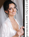 Close up portrait of gorgeous bride at hotel in morning. Charming woman with great hairstyle and 59210318