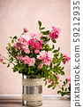 Pink roses arrangement in a vase 59212935