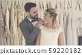 Bride and groom in wedding dress prepare ceremony. 59220182