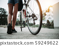 Close up woman legs shot and bicycle 59249622