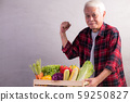 Healthy Asian senior man with crate full of fruits and vegetables 59250827