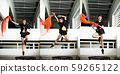 Jumping Girl model jumps on a trampoline and Pose 59265122