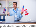 Young male travel agent working in the office 59265988