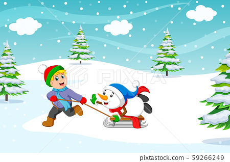 A boy and warm coat playing a sleigh ride with a snow 59266249