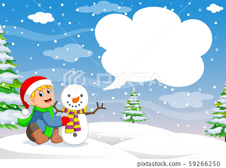 Funny little toddler boy in a red knitted Nordic hat and warm coat playing with a snow 59266250