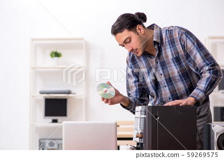 Young engineer repairing musical hi-fi system 59269575
