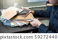 Asian architect man choosing wooden color swatch 59272440