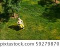 Woman reading in a backyard 59279870