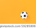 Soccer ball against trendy yellow background 59285806