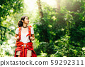 woman traveler with backpack walking in forest 59292311