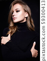 portrait of Beautiful young woman in black 59300413