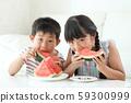 Boy and girl eating saijo 59300999