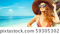 Happy young woman at beach in summer vacation. 59305302