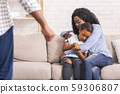Afro mother and daughter suffering from domestic violence of father 59306807
