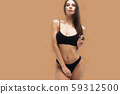 Sexy woman in underwear looking at camera 59312500
