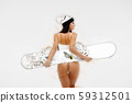 Seductive female smiling and carrying snowboard 59312501