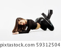 Attractive charming woman in leather suit and high 59312504