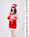 Beautiful portrait young asian woman happy holding credit card and red gift box in Christmas 59315050