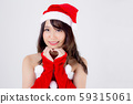 Beautiful portrait young asian woman Santa costume wear hat smiling gesture heart holiday xmas 59315061