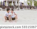 Homosexual portrait young asian couple sitting hug together on beach in summer 59315067