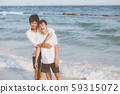 Homosexual portrait young asian couple standing hug together on beach in summer 59315072