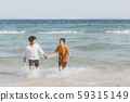Homosexual portrait young asian couple running with cheerful together on beach in summer 59315149