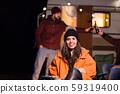 Portrait of young girl in front of retro camper van 59319400