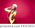 Lovely smiling woman in festive dress and Santa 59323031