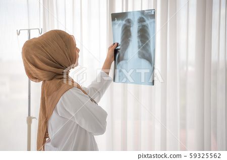 Muslim woman medical doctor looking at x-rays result in a hospital 59325562
