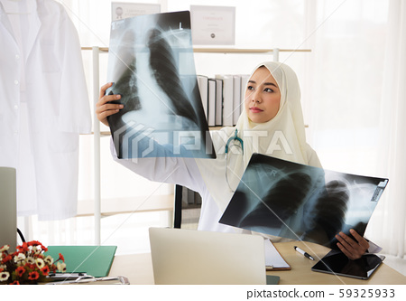 Muslim woman medical doctor looking at x-rays result in a hospital 59325933