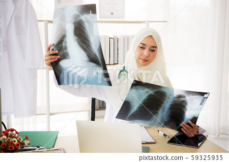 Muslim woman medical doctor looking at x-rays result in a hospital 59325935