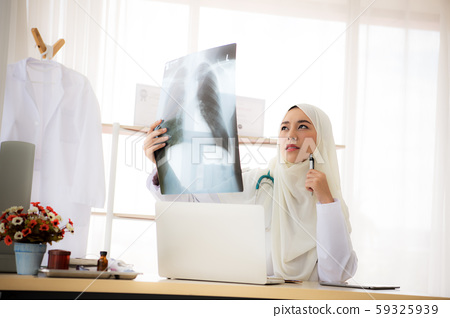 Muslim woman medical doctor looking at x-rays result in a hospital 59325939