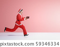 Asian man in Santa costume running 59346334