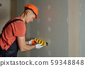 Making holes in the drywall. 59348848
