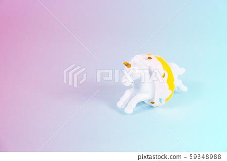Unicorn horse jumping through a donut 59348988