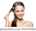 Smiling woman  coloring hair with brush 59354089