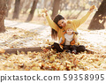 Young mother and baby sit yellow 59358995