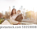 Young girl and child in a park 59359008
